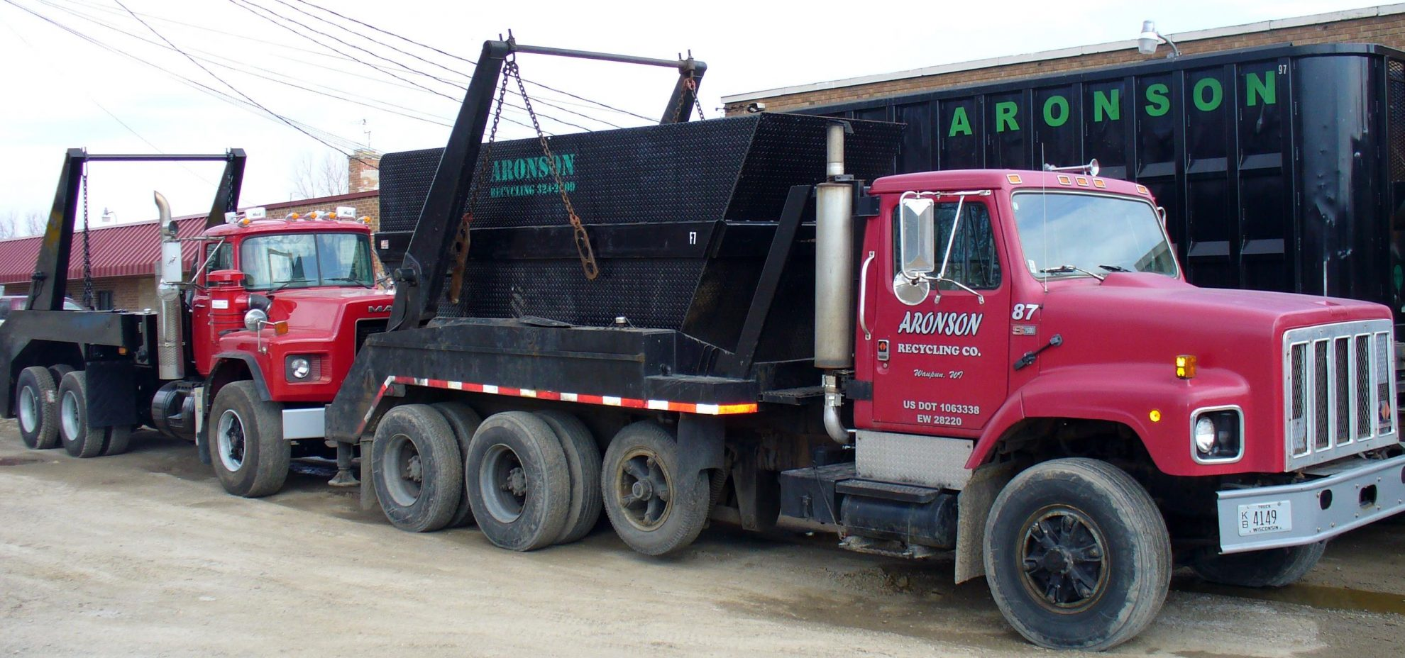 Image of Aronson Recycling trucks.